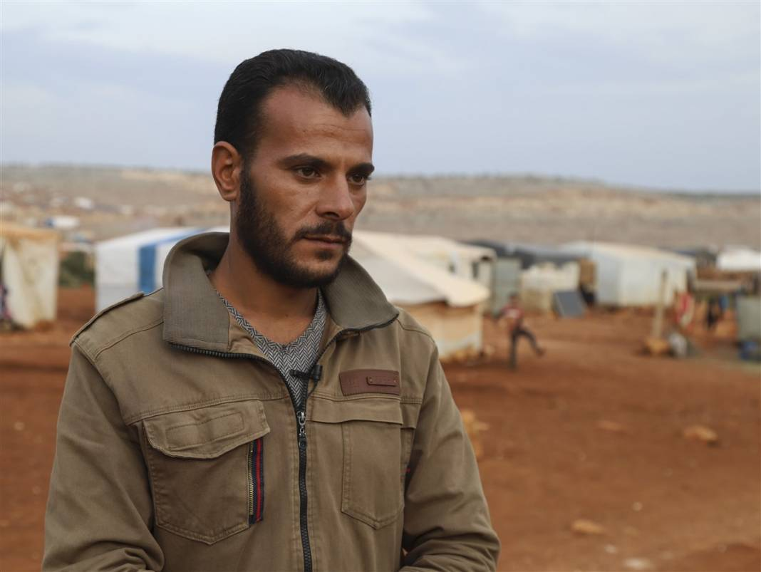 İdlib'de yüz binlerce sivil ısınmak isterken sağlığından oluyor 19